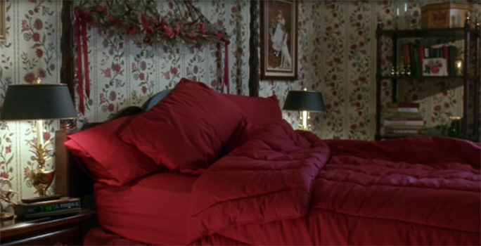 McCallister house Master Bedroom with maroon coloured sheets on the bed