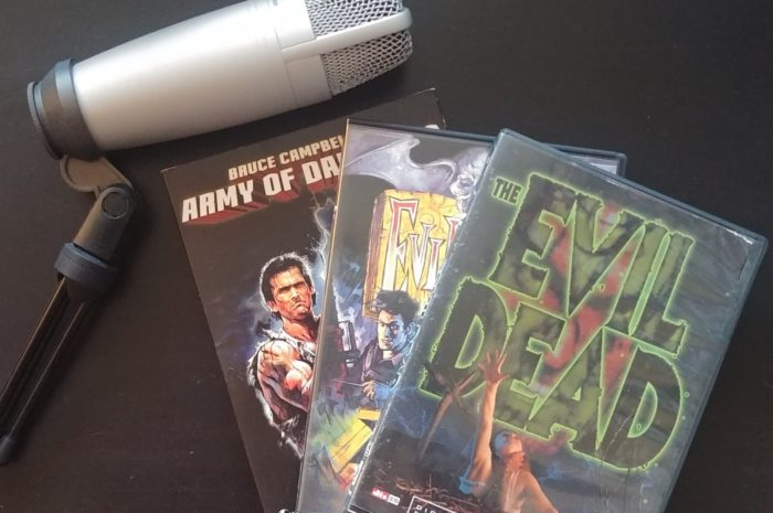 The evil dead trilogy dvd cases and a microphone